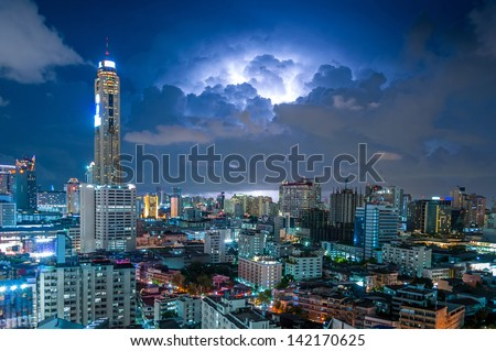Modern city view of Bangkok, Thailand. Atmosphere before rain. Lightning. - stock photo