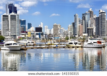 Modern city view - skyscrapers and luxury yachts with water reflection - Panama City - stock photo