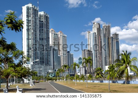 Modern city with high skyscrapers and the empty path - Panama City - stock photo