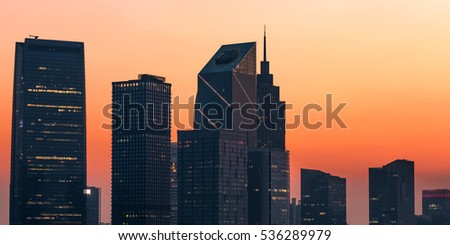 Modern City with Skylines at Sunset.