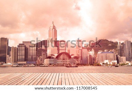 Modern city with sunshine sky (Hongkong) ,victoria harbour. - stock photo