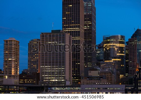Modern cityscape at evening background. Skyscrapers of Sydney downtown at blue hour. Copy space, long exposure