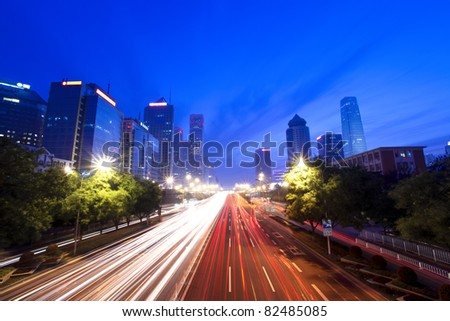 modern cityscape with traffic at dusk in beijing,China - stock photo