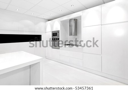 Modern clean and tidy kitchen with white elements - stock photo