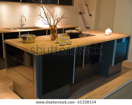 Modern clean design trendy kitchen made of black wooden elements - stock photo