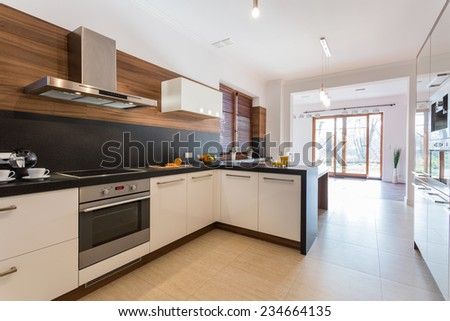 Modern clean kitchen open on bright spacious dining room - stock photo