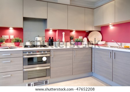 modern clean stylish kitchen with utensils, recipe book and ingredients ready on the worktop - stock photo