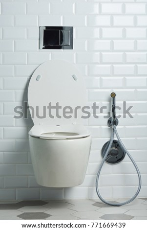 White Toilet With Black Seat. Modern clean white toilet seat in bathroom with elegant tile Toilet Bowl Stock Images  Royalty Free Vectors Shutterstock