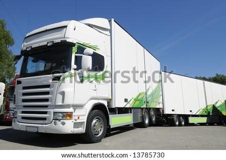 modern clean white truck driving on flexfuel - stock photo