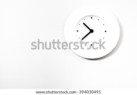 modern clock hanging at the wall with copy space - stock photo