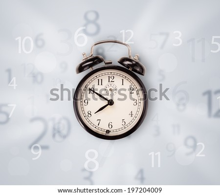 Modern clock with numbers on the side comming out - stock photo