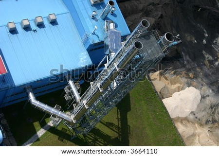 Modern coal and gas power plant. View from top of other chimney - stock photo