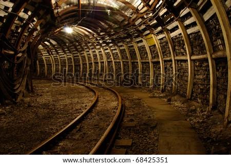 Modern coal mine Passageway in modern coal mine with tracks - stock photo
