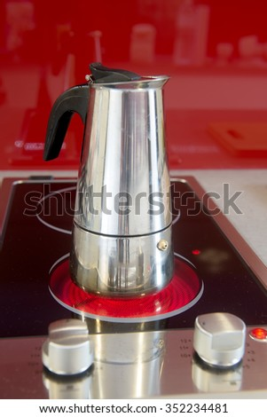 Modern coffee pot on the stove