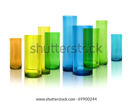 Modern color glass vases row on white reflective background - stock photo