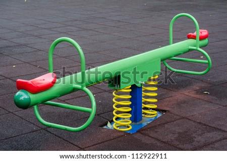 Modern colorful children playground in public park - stock photo