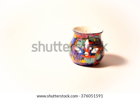 Modern colorful striped vase isolated over white background