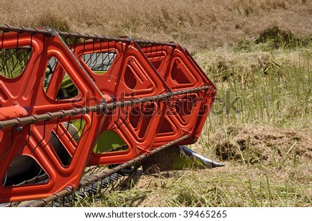 Modern combine harvester details in a field - stock photo