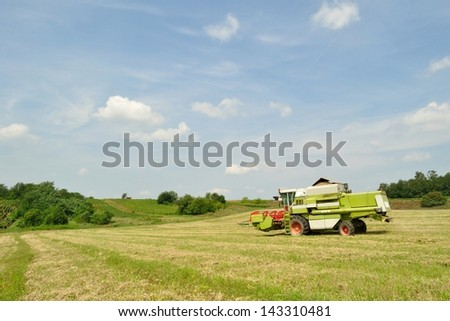 Modern combine harvester finished the harvesting in the wheat field