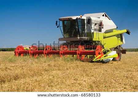 Modern combine in the field during harvesting - stock photo