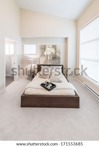 Modern comfortable and elegant luxury master bedroom. Interior design. Vertical. - stock photo
