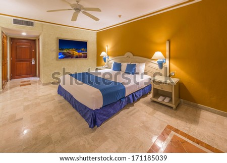 Modern comfortable and elegant master bedroom in a luxury resort hotel. Bahia Principe, Riviera Maya, Mexican Resort. Interior design. - stock photo