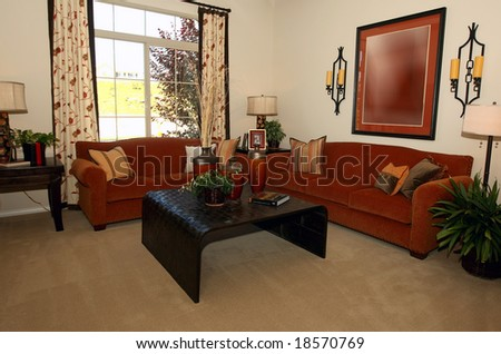 Modern comfortable living room in warm hues - stock photo