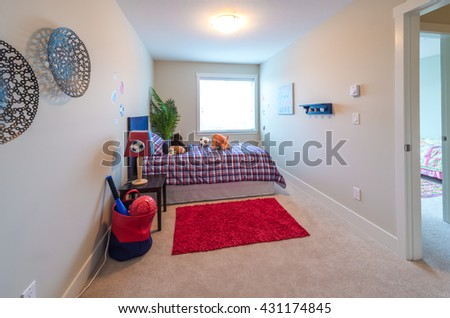 Modern comfortable, nicely decorated  bedroom for children with some toys. Interior design. - stock photo