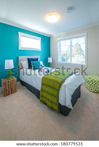 Modern comfortable, nicely decorated children bedroom painted in turquoise. Interior design. Vertical. - stock photo
