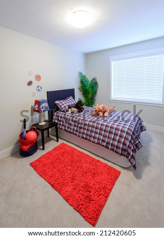 Modern comfortable, nicely decorated children bedroom with some toys. Interior design. Vertical. - stock photo
