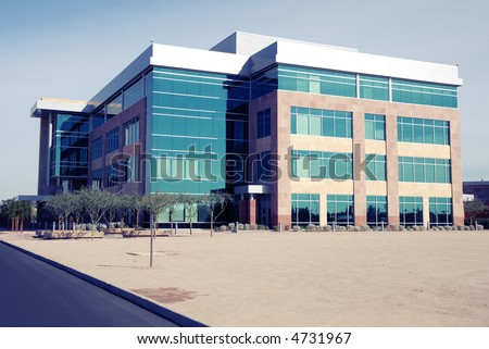 Modern Commercial Building: instant photo style, Shadows are blue, High Contrast.