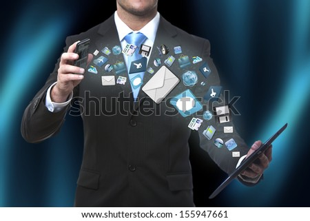 Modern communication technology illustration with mobile phone and tablet in hands of business men - stock photo