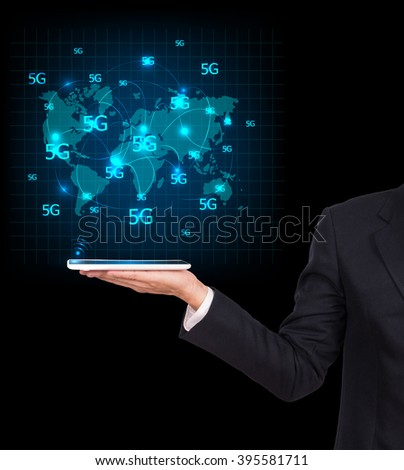 Modern communication technology tablets high tech, wide web connection concept. Hand holding white tablets connected browsing internet worldwide world map background. 5g data plan provider - stock photo