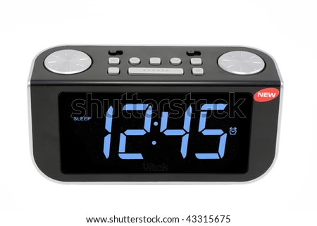 Modern compact digital electronic clock from radio. It is isolated on the white. MAss production. - stock photo