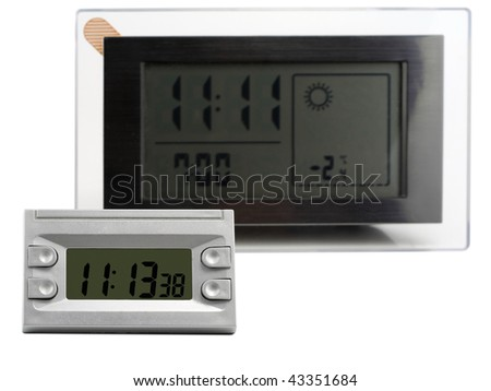 Modern compact small and large  digital electronic clock with radio. It is isolated on the white. Mass production. Selective focus. - stock photo
