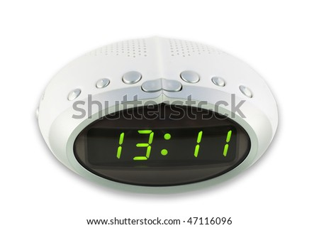 Modern compact white  digital electronic clock from radio. It is isolated on the white. MAss production. - stock photo