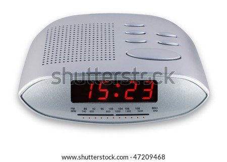 Modern compact white  digital electronic clock with analog radio scale. It is isolated on the white, with clipping path. Mass production. - stock photo