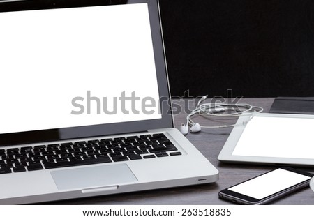 modern computer devices  - laptop, tablet and phone with copy space on display - stock photo
