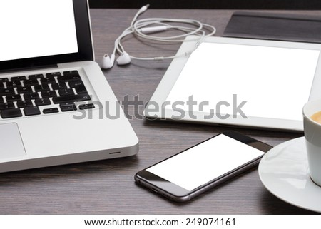 modern computer devices  - laptop, tablet and phone with copy space on screen - stock photo