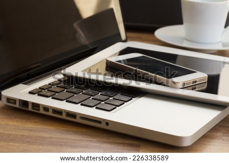 modern computer gadgets  - laptop, tablet and phone close up - stock photo