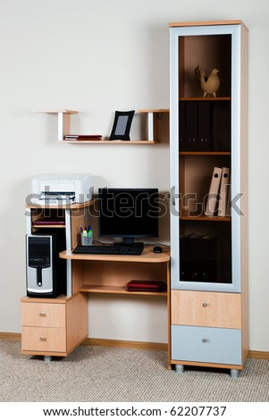 Modern computer on a wooden desk at office - stock photo