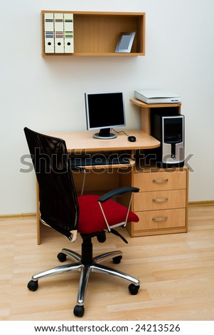 Modern computer on a wooden table at office