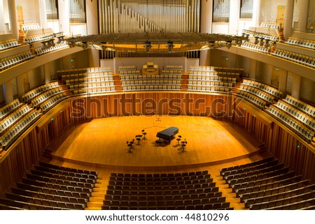 modern concert hall with piano on the center stage - stock photo