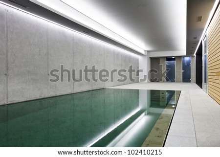 modern concrete house , indoor pool - stock photo
