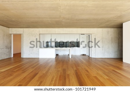 modern concrete house with hardwood floor,  kitchen - stock photo