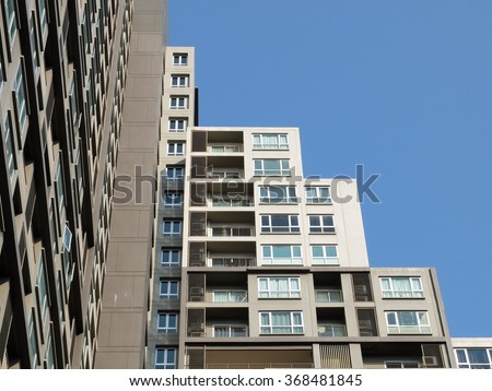 Modern condominium with blue sky background. - stock photo