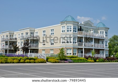 Modern Condominiums in urban setting under blue sky - stock photo