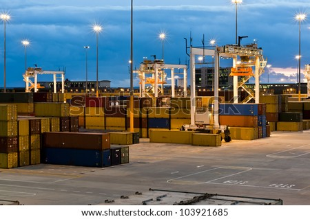 Modern Container Port Terminal, Harbour in South Africa by night - stock photo