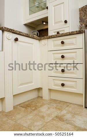 Modern contemporary kitchen interior with granite worktop and cream units - stock photo