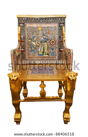 Modern copy of the Golden Throne of king Tutankhamen isolated with clipping path. On the back the image of the Pharaoh and queen Ankhesenamun - stock photo